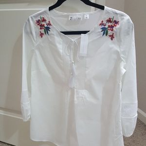 White peasant top with embroidery on shoulders